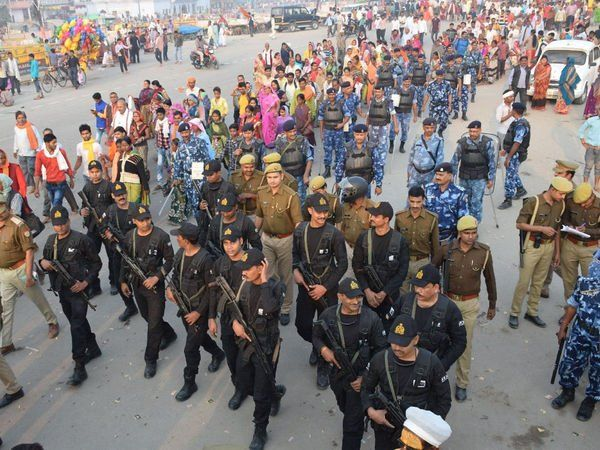 Security forces conduct flag march